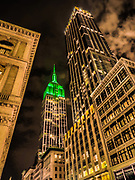 The Empire State Building lit up in Green color in Manhattan, New York City.
