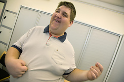 A day Service users with learning disabilities using makaton a way of communicating with signs and symbols specially for people with learning difficulties,