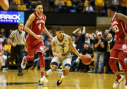 Jan 6, 2018; Morgantown, WV, USA; West Virginia Mountaineers guard James Bolden (3) dribbles through defenders during the second half against the Oklahoma Sooners at WVU Coliseum. Mandatory Credit: Ben Queen-USA TODAY Sports