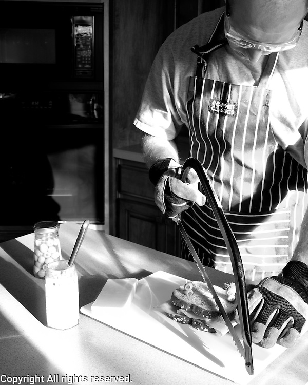 Another take on the unexpected.  Using yard tools to make my lunch.  I like the strong directional light used for this portrait.  I also like working with food since those kinds of sessions end with a full stomach.