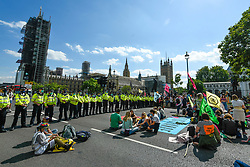 © Licensed to London News Pictures. 01/09/2020. LONDON, UK. A visible police presence is in effect as activists from Extinction Rebellion take part in a climate change protest in Parliament Square on the day that Members of Parliament return to Westminster after the summer recess.  Photo credit: Stephen Chung/LNP