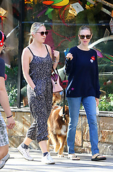 September 14, 2016 - New York, New York, United States - Actress Amanda Seyfried (R) walks her dog Finn after anouncing her engagement to Thomas Sadowski on September 14 2016 in New York City  (Credit Image: © Zelig Shaul/Ace Pictures via ZUMA Press)