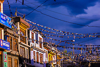 Prayer flags hang from buildings along Main Bazaar Road in old Leh, Ladakh, Jammu and Kashmir State, India.