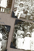 hildhood and family images in a photo album