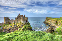 Dunluce Castle is located dramatically close to a headland that plunges straight into the sea, along the North Antrim coast in Northern Ireland, and was the headquarters of the MacDonnell Clan. There is archaeological evidence of a village that surrounded the castle which was destroyed by fire in 1641. The site was also witness to the sinking of a colony ship that broke up on the rocks off Islay in 1857 with the loss of 240 lives.