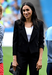 The Duchess of Sussex meets people taking part in a Gaelic games demonstration during a visit to Croke Park on the second day of their visit to Dublin, Ireland. Photo credit should read: Doug Peters/EMPICS