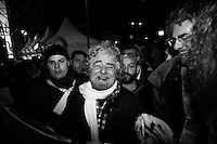 "ROME, ITALY - 22 FEBRUARY 2013: Beppe Grillo, a comedian and leader of the 5 Stars Movement (M5S, Movimento 5 Stelle) rallies during the last rally of his ""Tsunami Tour"" in Piazza San Giovanni, in Rome on February 22, 2013. Wrapping up his election campaign in Rome, Grillo said ""there are 800,000 thousand of you here - with 150,000 watching our live streaming, and 120 squares in Italy watching us"".<br /> <br /> Grillo, whom presents itself as a ""non-politician"", and the 5 Stars Movement as ""not a party"", has been running a mostly internet-based political campaign through the party's blog and the local groups that have emerged from it. The movement has a strong anti-politics agenda: ""All political parties are crooked and they all need to go"", Grillo says.<br /> <br /> <br /> A general election to determine the 630 members of the Chamber of Deputies and the 315 elective members of the Senate, the two houses of the Italian parliament, will take place on 24–25 February 2013. The main candidates running for Prime Minister are Pierluigi Bersani (leader of the centre-left coalition ""Italy. Common Good""), former PM Mario Monti (leader of the centrist coalition ""With Monti for Italy"") and former PM Silvio Berlusconi (leader of the centre-right coalition).<br /> <br /> ###<br /> <br /> ROMA, ITALIA - 22 FEBBRAIO 2013: Beppe Grillo, comico e leader del Movimento 5 Stelle (M5S), fa un comizio durante la tappa finale dello ""Tsunami Tour""  a Piaza San Giovanni, a Roma il 22 febbraio 2013. A conclusione del comizio, Beppe Grillo ha dichiarato: ""Siamo 800.000 e 150.000 in streaming, con 120 piazze collegate"".<br /> <br /> Grillo, il quale si presenta come un ""non-politica"", e il Movimento 5 Stelle come un ""non-partito"", svolge la maggior parte della propria campagna elettorale su internet, tramite il suo blog e i meetup locali. Il movimento ha un'agenda dalle connotazioni antipolitiche: ""I partiti sono finiti e i politici se ne devono andare"", sostiene Grillo.<br /> <br /> Le elezioni politiche italiane del 2013 per il rinnovo dei due rami del Parlamento i"