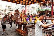 An idol from a local temple is danced at another temple's Taoist ceremony.