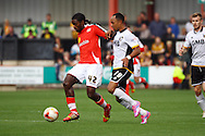 Crewe Alexandra's Anthony Grant (l) looks to get away from Port Vale's Byron Moore. Skybet football league one match, Crewe Alexandra v Port Vale at the Alexandra Stadium in Crewe on Saturday 13th Sept 2014.<br /> pic by Chris Stading, Andrew Orchard sports photography.