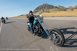 Debi Holmes riding south on highway 79 on the Run to the Line for lunch and biker vs Cowboy rodeo games at the Spur Creek Ranch in Newell during the annual Sturgis Black Hills Motorcycle Rally. SD, USA. Wednesday August 9, 2017. Photography ©2017 Michael Lichter.