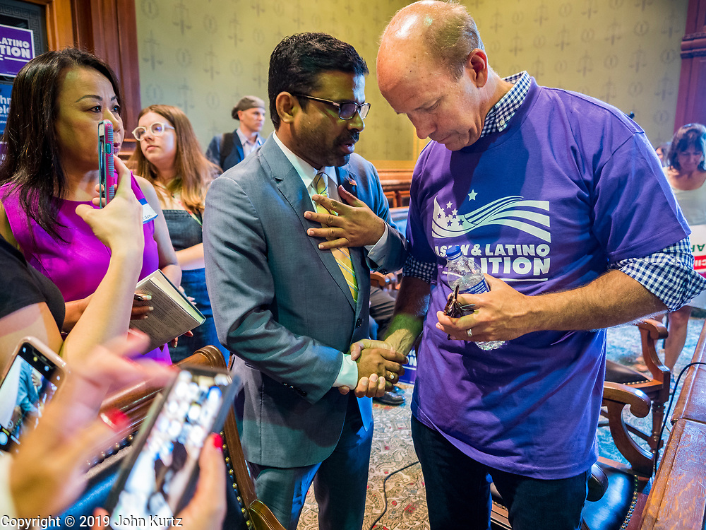 29 JUNE 2019 - DES MOINES, IOWA: PRAKASH KOPPARAPU, left, talks to JOHN DELANEY, former Maryland Congressman, after Delaney spoke at a town hall meeting sponsored by the Asian and Latino Coalition. Delaney is running to be the Democratic nominee for the US Presidency in the 2020 election. He was the first Democratic presidential candidate to visit all 99 of Iowa's counties in the 2020 cycle. Iowa traditionally hosts the the first election event of the presidential election cycle. The Iowa Caucuses will be on Feb. 3, 2020.     PHOTO BY JACK KURTZ