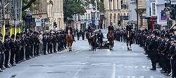 © Licensed to London News Pictures. 14/10/2019. Oxford, UK. A funeral cortege makes it way down the High Street which is lined by police officers in Oxford city centre for the funeral of Thames Valley Police officer PC Andrew Harper. Photo credit: Peter Manning/LNP