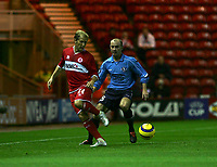 Photo: Andrew Unwin.<br />Middlesbrough v Dnipro. UEFA Cup. 03/11/2005.<br />Middlesbrough's Gaizka Mendieta (L) is put under pressure by Dnipro's Serhiy Nazarenko (R).