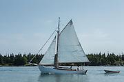 Fox Island Thorofare, ME - 11 August 2014. A cutter sailing through Fox Island Thorofare.