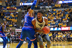 Jan 19, 2019; Morgantown, WV, USA; West Virginia Mountaineers forward Derek Culver (1) looks to make a move in the lane during the second half against the Kansas Jayhawks at WVU Coliseum. Mandatory Credit: Ben Queen-USA TODAY Sports