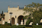 """The most holy spot in the Bahá'í world: Bahji, near Acre, Israel, the resting place of Bahá'u'lláh's earthly remains. Surrounded by gardens, the mansion of Bahji (Arabic for """"delight"""" or """"joy"""") is visited by thousands of pilgrims every year. Their focus is the small garden house to the right of the main mansion, where Bahá'u'lláh's physical remains are buried."""