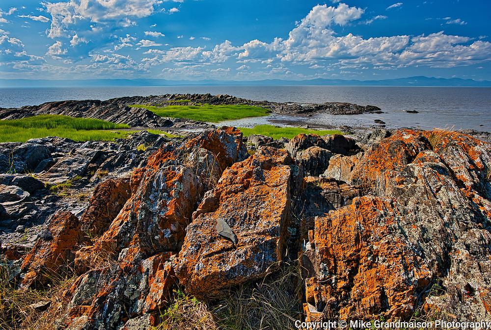 Rocky shoreline along the St. Lawrence River<br />Saint-Roch-des-Aulnaies<br />Quebec<br />Canada