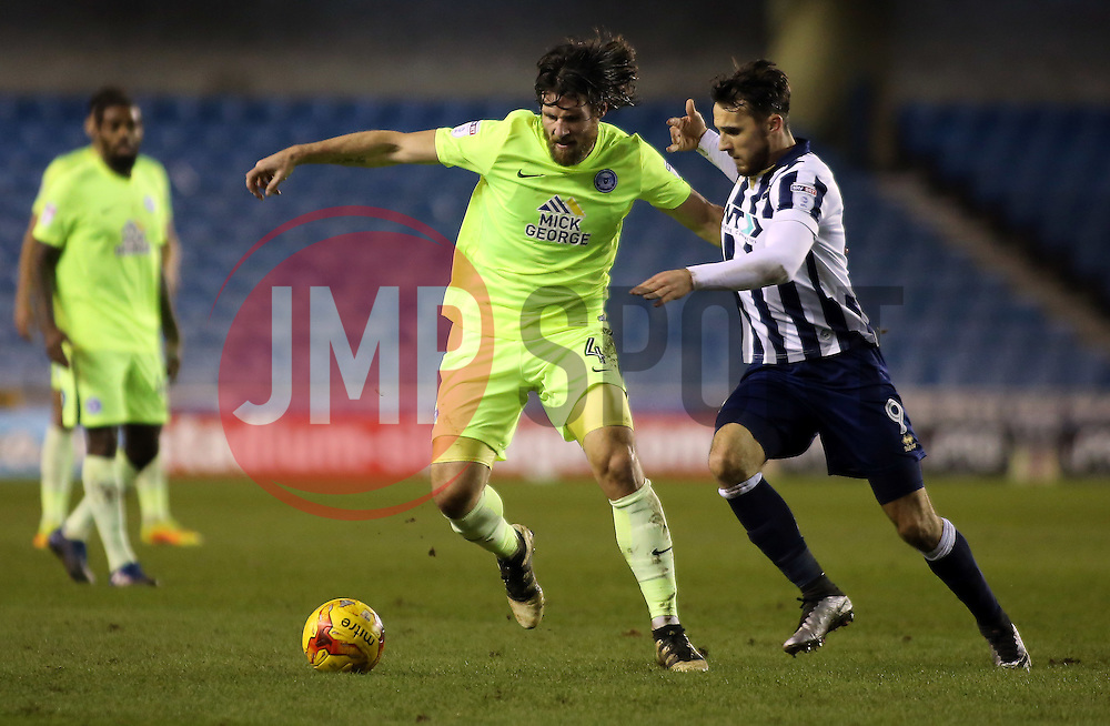 Michael Bostwick of Peterborough United in action with Lee Gregory of Millwall - Mandatory by-line: Joe Dent/JMP - 28/02/2017 - FOOTBALL - The Den - London, England - Millwall v Peterborough United - Sky Bet League One