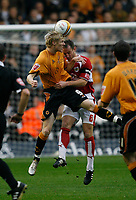 Photo: Steve Bond/Sportsbeat Images.<br /> Wolverhampton Wanderers v Bristol City. Coca Cola Championship. 03/11/2007. Andy Keogh (L) tries to turn the ball past Louis Carey (C)