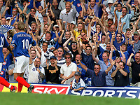 Teddy Sheringham (Portsmouth) celebrates with the Pompey fans after scoring goal no 1.  Portsmouth v Aston Villa. 16/8/2003. Credit : Colorsport/Andrew Cowie.