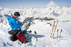 Man Alps reading map skier cross-country