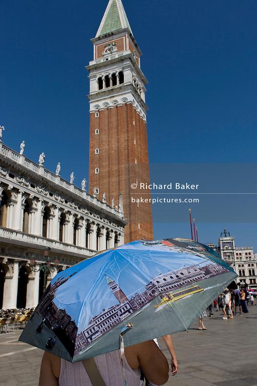 Tourist umbrella beneath the Campanile in Piazza San Marco