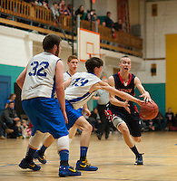 Pittsfield's Elias Doucette struggles to maintain control over the ball guarded by Concord Christian's Nick Peter's during Friday night's varsity basketball at Concord YMCA.  (Karen Bobotas/for the Concord Monitor)