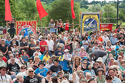 © Licensed to London News Pictures.17/07/2016. Tolpuddle, Dorset, UK. Tolpuddle Martyrs trade union festival procession. Jeremy Corbyn laid a wreath at the martyrs grave in the churchyard, joined the procession of trade unionists through the village and spoke from the main stage. Photo credit : Simon Chapman/LNP