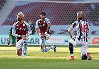 Football - 2020 / 2021 Premier League - Aston Villa vs West Bromwich Albion - Villa Park<br /> <br /> Tyrone Mings of Aston Villa takes the knee