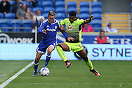 Craig Noone of Cardiff city (l) holds off Gareth McCleary of Reading. EFL Skybet championship match, Cardiff city v Reading at the Cardiff city stadium in Cardiff, South Wales on Saturday 27th August 2016.<br /> pic by Andrew Orchard, Andrew Orchard sports photography.