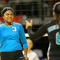 111414  Adron Gardner/Independent<br /> <br /> Navajo Prep Eagle Jasmine Coleman (9) celebrates after an Eagle score on the Tularosa Wildcats during the New Mexico state volleyball quarterfinals at the Santa Ana Star Center in Rio Rancho Friday.