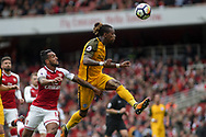 Gaetan Bong of Brighton Heads back to the goalkeeper under pressure from Theo Walcott of Arsenal . Premier league match, Arsenal v Brighton & Hove Albion at the Emirates Stadium in London on Sunday 1st October 2017. pic by Kieran Clarke, Andrew Orchard sports photography.