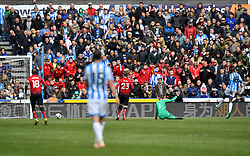 Huddersfield Town's Isaac Mbenza scores his side's first goal of the game during the Premier League match at the John Smith's Stadium, Huddersfield.