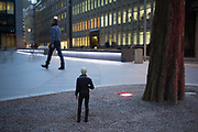 Miniature statue of a man in the City of London, UK. These tiny public sculptures interract with passers by in a play on scale.