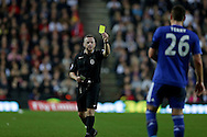 Referee Jonathan Moss booking John Terry, the Chelsea captain for fouling Samir Carruthers of MK Dons. The Emirates FA cup, 4th round match, MK Dons v Chelsea at the Stadium MK in Milton Keynes on Sunday 31st January 2016.<br /> pic by John Patrick Fletcher, Andrew Orchard sports photography.
