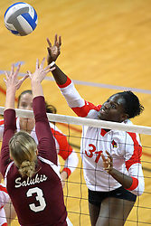 05 November 2010: Hailey Kelley tips the ball past Alsia Mayes during an NCAA volleyball match between the Southern Illinois Salukis and the Illinois State Redbirds at Redbird Arena in Normal Illinois.