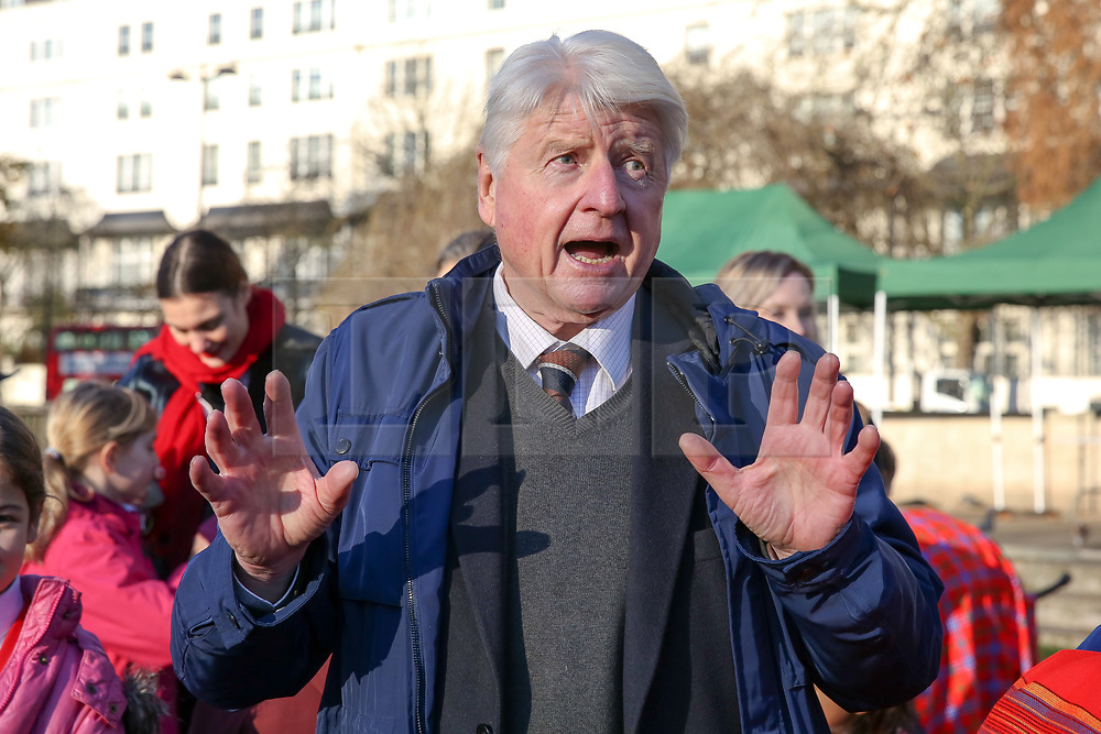 © Licensed to London News Pictures. 04/12/2019. London, UK. Author and father of the Prime Minister BORIS JOHNSON, STANLEY JOHNSON speaks at unveiling of life-sized herd of 21 bronze elephants at Marble Arch.<br /> Children unveil a herd of 21 bronze elephants at Marble Arch. The sculpture is the largest such depiction of an elephant herd in the world and is intended to draw attention to the plight of this species that could be extinct on current trends, by 2040. Each elephant in the sculpture is modelled after a real orphaned animal currently in the care of the Sheldrick Wildlife Trust. Left behind by poachers and other sources of human-wildlife conflict these animals have been raised by the trust in an effort to secure the future of the species. The herd will be displayed until 4 December 2020. Photo credit: Dinendra Haria/LNP