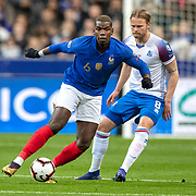 PARIS, FRANCE - March 25:  Paul Pogba #6 of France defended by Birkir Bjarnason #8 of Iceland during the France V Iceland, 2020 European Championship Qualifying, Group Stage at  Stade de France on March 25th 2019 in Paris, France (Photo by Tim Clayton/Corbis via Getty Images)