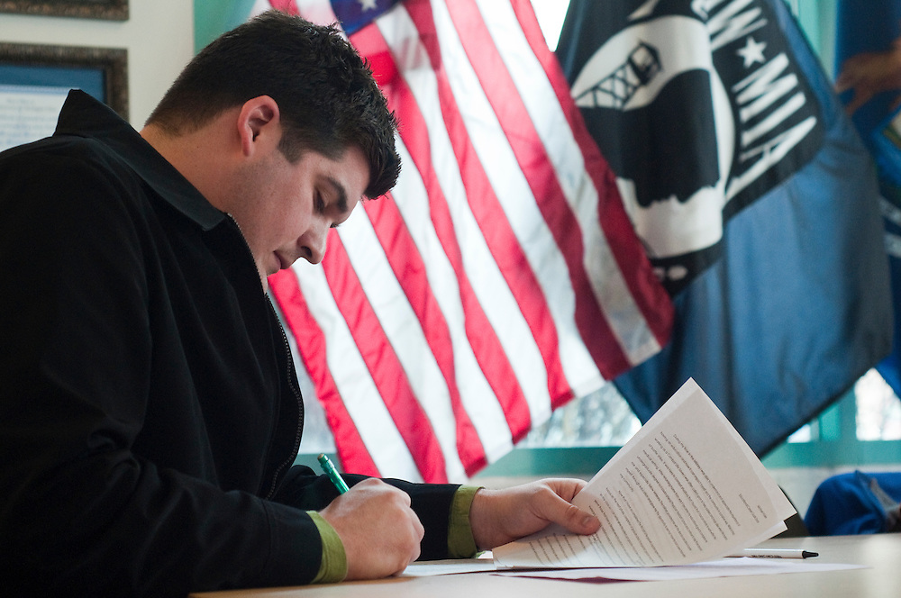 Matt Dixon   The Flint Journal..UM-Flint student and Army veteran Michael Voiles, 24, looks over his work during an essay writing workshop for the Pat Tillman Foundation scholarship held in the UM-Flint pavilion, Tuesday, March 8. The Pat Tillman Foundation has recognized UM-Flint (which includes an office and lounge for veterans) as a veteran friendly university.