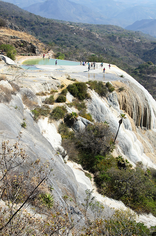 """The mineral springs of Hierve el Agua have formed """"petrified waterfalls"""" on the cliff face."""