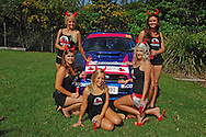 Red Devil Energy Drink Promo Girls .Media Day/Shakedown.Red Devil Energy Drink Rally of Queensland.Nambour Showgrounds, Nambour, Sunshine Coast, Qld.8th of May 2009.(C) Joel Strickland Photographics.Use information: This image is intended for Editorial use only (e.g. news or commentary, print or electronic). Any commercial or promotional use requires additional clearance.
