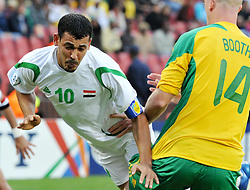 090614) -- JOHANNESBURG, June 14, 2009  -- Iraq's Younis Mahmoud (L) vies with Matthew Booth of South Africa during the opening match at the FIFA Confederations Cup in Johannesburg, South Africa, June 14, 2009. Xu Suhui) (bmm) (Credit Image: © Xinhua/ZUMA Press)