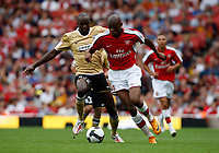 Photo: Richard Lane/Richard Lane Photography. Arsenal v Juventus. Emirates Cup. 02/08/2008. Arsenal's Abou Diaby is challenged by Juventus' Mohamed Sissoko.
