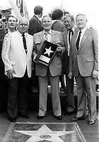 1986 Gene Autry holds the plaque at Smiley Burnette's posthumous Walk of Fame ceremony