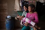 Lima, Peru. Jicamarca. Teresa Sedano Unocc playng with her younger sister