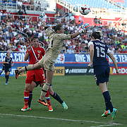 U.S.midfielder Megan Rapinoe (15) heads the ball against Russia goalkeeper Elvira Todua (1) during an international friendly soccer match between the United States Women's National soccer team and the Russia National soccer team at FAU Stadium on Saturday, February 8, in Boca Raton, Florida. (AP Photo/Alex Menendez)