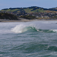 Back wash waves made possible by the new wall put in and extended meters out into the see early 21st century