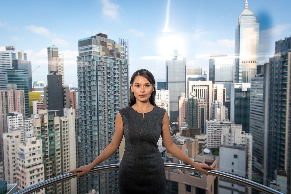 Maxine Ryan, co-founder and chief operating officer of Bitspark Ltd., stands for a photograph in in Hong Kong, China, on Thursday, Nov. 16, 2017. Ryan dropped out of university to launch Bitspark in Hong Kong, where she was born. Its initial coin offering last month raised $1.4 million. Photographer: David Paul Morris