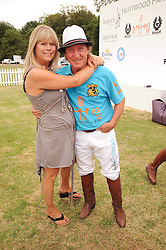 Asprey World Class Cup polo held at Hurtwood Park Polo Club, Ewhurst, Surrey on 17th July 2010.<br /> Picture shows:-KENNEY & JAYNE JONES