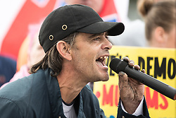 © Licensed to London News Pictures . 29/07/2017 . Rochdale , UK . EDL leader IAN CROSSLAND speaks at the rally . Far-right street protest movement , the English Defence League ( EDL ) , hold a demonstration in Rochdale , opposed by anti-fascists , including Unite Against Fascism ( UAF ) . The EDL say they are demonstrating against the sexual grooming and abuse of English girls by Muslim men in Rochdale and against terrorism across the UK . Photo credit : Joel Goodman/LNP